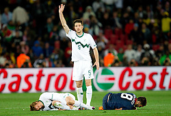 Nejc Pecnik of Slovenia injured by Clint Dempsey of USA (R), Bostjan Cesar of Slovenia (C) calling a referee during the 2010 FIFA World Cup South Africa Group C match between Slovenia and USA at Ellis Park Stadium on June 18, 2010 in Johannesberg, South Africa. (Photo by Vid Ponikvar / Sportida)
