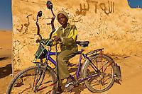 Boy with bicycle, Nubian village near Aswan, Egypt