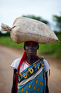 A woman on the road between Juba and Yao which is slowly being resettled as refugees return.