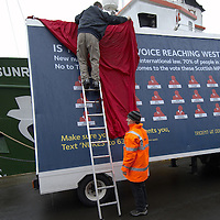 Greenpeace ship MV Arctic Sunrise in Leith, Edinburgh, to launch the Scottish leg of Greenpeace's  'Trident:We Don't Bui It' Tour. Billboard with the names of Scottish Labour who suppoprt replacing Trident or are not commited to vote against it.MPs
