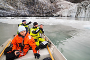 Glaciologists Agnieszka Piechota (l-r), Jacek Jania, and Dariusz Ignatiuk take pictures of the terminus of Paierlbreen glacier in Hornsund, Svalbard.