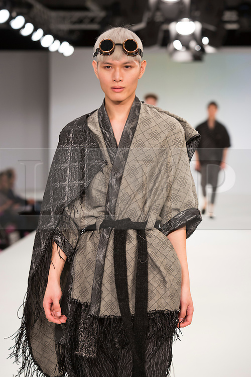 © Licensed to London News Pictures. 30/05/2015. London, UK. A model walks the runway during the Arts University Bournemouth fashion show at Graduate Fashion Week 2015 wearing the collection of graduate student Grant Brown. Graduate Fashion Week takes place from 30 May to 2 June 2015 at the Old Truman Brewery, Brick Lane. Photo credit : Bettina Strenske/LNP