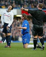Photo: Scott Heavey<br />Chelsea V Tottenham Hotspur. 01/02/03. <br />Simon disagrees with Paul Dirkins decision against Emmanuel Petit  during this premiership clash at Stamford Bridge.