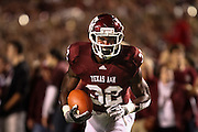 Nov 20, 2010; College Station, TX, USA; Texas A&M Aggies running back Cyrus Gray (32) warms up before the game against the Nebraska Cornhuskers at Kyle Field.  Mandatory Credit: Thomas Campbell-US PRESSWIRE