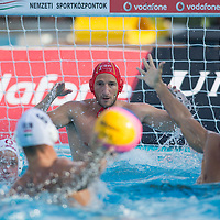Norbert Hosnyanszky (front C) of Hungary shoots the goal as goalkeeper Inaki Aguilar (back C) of Spain prepares to save a goal during the Vodafone Waterpolo Cup in Budapest, Hungary on July 15, 2012. ATTILA VOLGYI