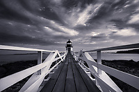 Black and White photograph of Marshall Point Lighthouse on the coast of Maine.