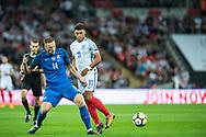 (11) Alex Oxlade-Chamberlain, Slovakia (14) Milan SKRINIAR during the FIFA World Cup Qualifier match between England and Slovakia at Wembley Stadium, London, England on 4 September 2017. Photo by Sebastian Frej.