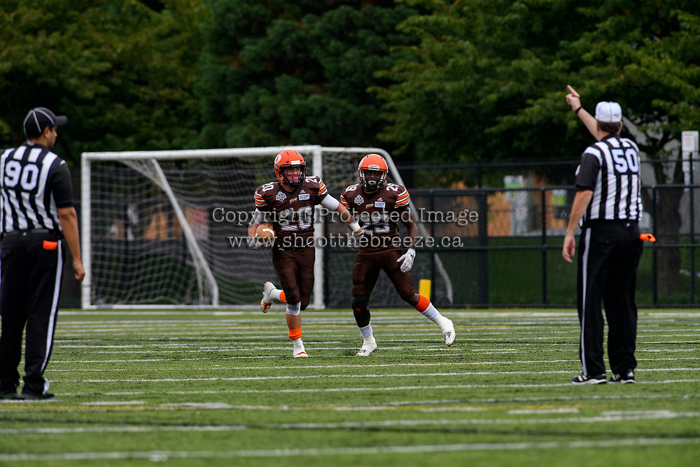 CHILLIWACK, BC - SEPTEMBER 11: Tyler Going #20 and Romario Reid #29 of Okanagan Sun celebrate an interception from the Westshore Rebels at Exhibition Stadium in Chilliwack, BC, Canada. (Photo by Marissa Baecker/Shoot the Breeze)