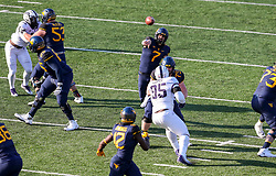 Nov 10, 2018; Morgantown, WV, USA; West Virginia Mountaineers quarterback Will Grier (7) throws a touchdown pass to West Virginia Mountaineers wide receiver Gary Jennings Jr. (12) during the third quarter against the TCU Horned Frogs at Mountaineer Field at Milan Puskar Stadium. Mandatory Credit: Ben Queen-USA TODAY Sports