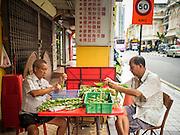06 JUNE 2015 - KUALA LUMPUR, MALAYSIA: Men clean vegetables at a Chinese street food shop in Kuala Lumpur.    PHOTO BY JACK KURTZ