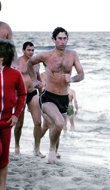 Prince Charles,Prince of Wales takes an early morning dip and run on the beach in Perth, Australia in April 1983. Photographed by Jayne Fincher