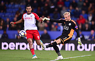 Kasper Schmeichel , the goalkeeper of Leicester city kicks the ball out as he is chased down by Solomon Rondon of West Bromwich Albion .Premier league match, Leicester City v West Bromwich Albion at the King Power Stadium in Leicester, Leicestershire on Monday 16th October 2017.<br /> pic by Bradley Collyer, Andrew Orchard sports photography.