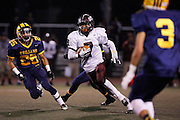 Piedmont Hills' quarterback Aaron Tillak (7) carries the ball against Milpitas during the CCS Division 1 playoff game at Milpitas High School in Milpitas, California, on November 29, 2013. No. 2 Milpitas beat No. 3 Piedmont Hills 45-0. (Stan Olszewski/SOSKIphoto)