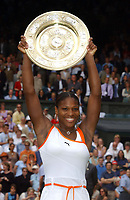 Serena Williams (USA) holds aloft the Womens Singles Championship Plate. Wimbledon Tennis Championship, Day 12, 5/07/2003. Credit: Colorsport / Matthew Impey DIGITAL FILE ONLY