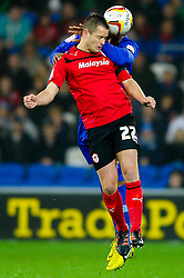 Cardiff Forward Heioar Helguson (ISL) and Watford Defender Fitz Hall (ENG) compete in the air during the first half of the match - Photo mandatory by-line: Rogan Thomson/JMP - Tel: Mobile: 07966 386802 23/10/2012 - SPORT - FOOTBALL - Cardiff City Stadium - Cardiff. Cardiff City v Watford - Football League Championship