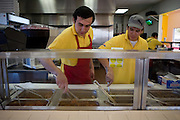 .Employees stir the burrito fillings at the new Burritos Crisostomo in El Paso Texas on Sunday morning, Oct. 11, 2009..