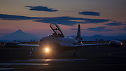 Greg Colyer taxiing past Mt. Hood in his Canadair CT33  at sunset at the Airshow of the Cascades.