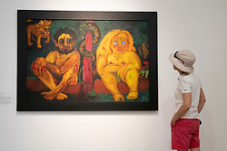 Woman looking at painting Verlorenes Paradies ( Paradise Lost) by Emile Nolde at Hamburger Bahnhof art museum in Berlin, Germany. .Editorial Use Only.