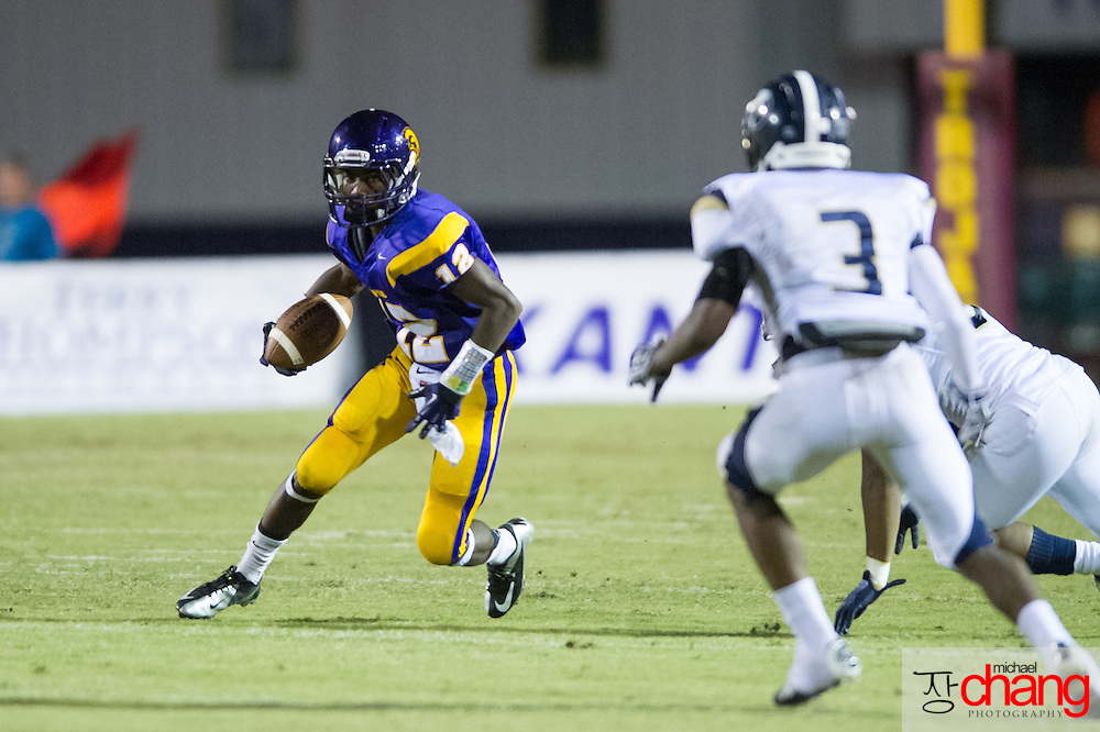 Daphne's Wheylen Tolbert (12) looks downfield for an opening while playing against Foley at Jubilee Stadium Friday, Sept. 14, 2012, in Mobile, Ala. At halftime Foley leads Daphne 16-7. (Press-Register, Michael Chang) SPORTS