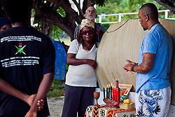 Vicki Bernett looks on as Akinyemi Blake explains the Kuumba, the sixth principle of Kwanzaa,  which means Creativity.