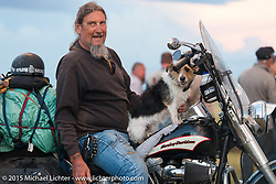 Ed Reiken of Kingston Springs, TN with his dog Jaxson for Chris Callen and Heather's wedding at the Broken Spoke Campgrounds during the 75th Annual Sturgis Black Hills Motorcycle Rally.  SD, USA.  August 8, 2015.  Photography ©2015 Michael Lichter.