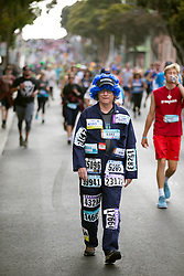 Bradford Lee of Concord, Calif., descends the Hayes Street hill as he participates in his 26th straight Bay to Breakers, Sunday, May 20, 2018, in San Francisco. (Photo by D. Ross Cameron)