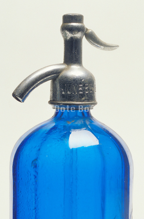 close up of blue antique seltzer water bottle