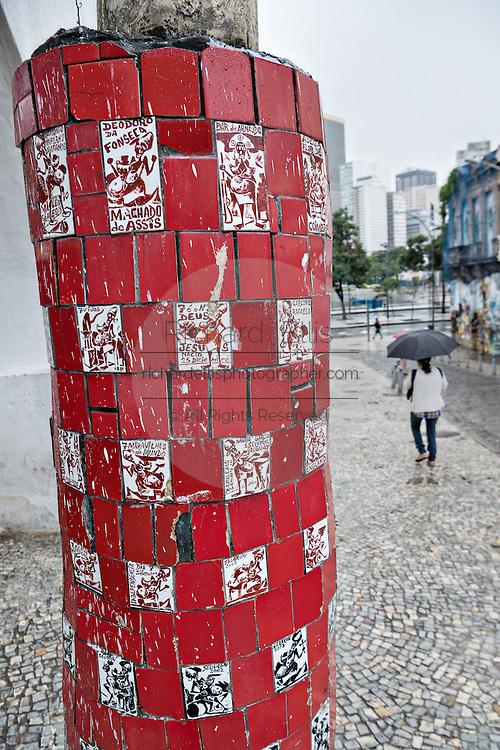 A tile art work around a telephone pole in the Lapa neighborhood of Rio de Janeiro, Brazil.