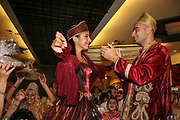 The bride and groom to be, at a Jewish Moroccan, henna ceremony<br /> The Hina, also Henna, ceremony proceeds the wedding day. In this festive ceremony, natural red dye is applied on the hands of the participants especially the bride and groom, to symbolize happiness, wealth and a successful union of the young couple.