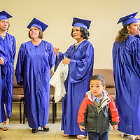 060515  Adron Gardner/Independent<br /> <br /> Graduates don their caps and gowns  before the New Life Learning GED program graduation at the Lighthouse Church in Gallup Friday.