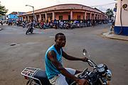 A taxiboy waits for clients for a moto ride in the streets fo São Tomé, the capital city of São Tomé e Príncipe