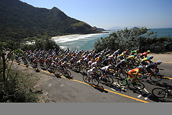 The Peloton in action along the coastline during the Men's Road race which takes place on the Copacabana on the first day of the Rio Olympics Games, Brazil.