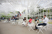 People enjoying climbing up the Serpentine Pavilion 2013 by Japanese architect, Sou Fujimoto. London, England, UK. He is the thirteenth and, at 41, youngest architect to accept the invitation to design a temporary structure for the Serpentine Gallery.