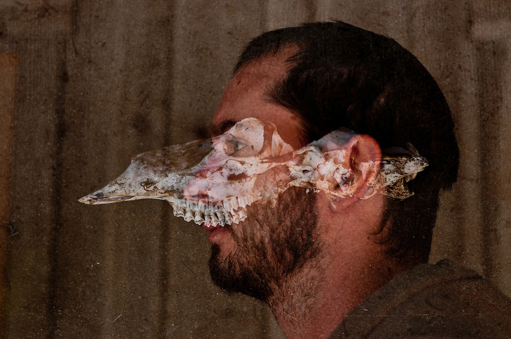 A multiple exposure photography of a man in profile with a deer skull.