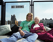 Sam and Eve Branson, son and mother of tycoon Sir Richard, relax together on a roof terrace in Manhattan, New York. Both are queueing to join the hundreds already having paid their $200,000 for Virgin Galactic's space tourism rides in 2009. Launched in September 2004 by Sir Richard Branson, Virgin Galactic will invest up to $250 million to develop the world's first commercial space tourism business with the building, testing and flying of five space shipShipTwos and two mother ships. It is expected that within the first full year of commercial operations Virgin Galactic will enable 500 people to fulfil their dreams of becoming astronauts. Aboard the space vehicle will be 6 passengers, each paying $200,000 for the 40 minute flight to 360,000 feet (109.73km, or 68.18 miles) and to experience 6 minutes of weighlessness.