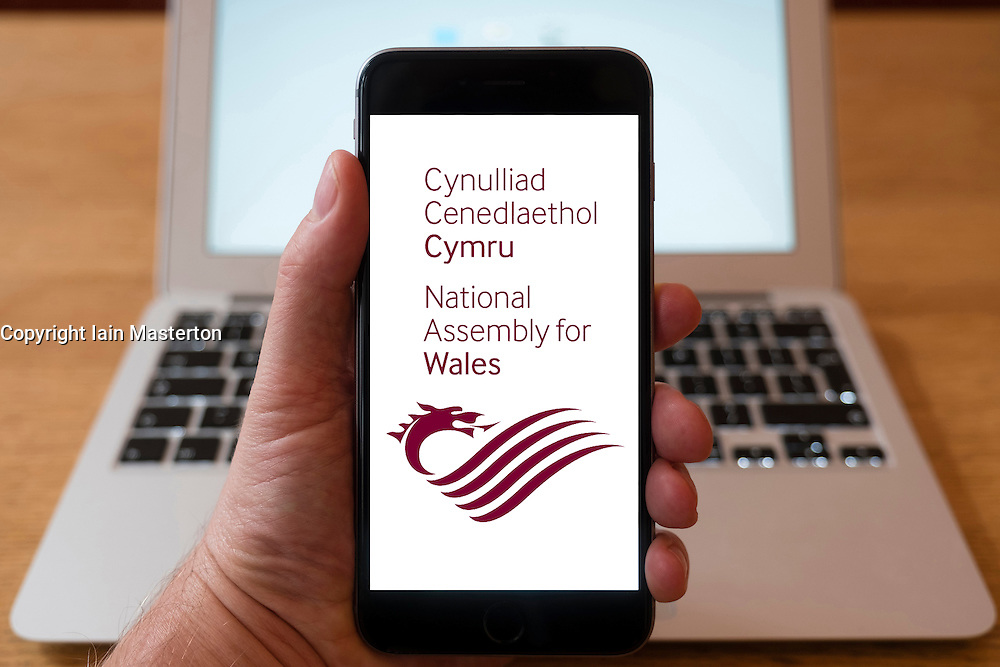 Using iPhone smartphone to display website of the National Assembly for Wales