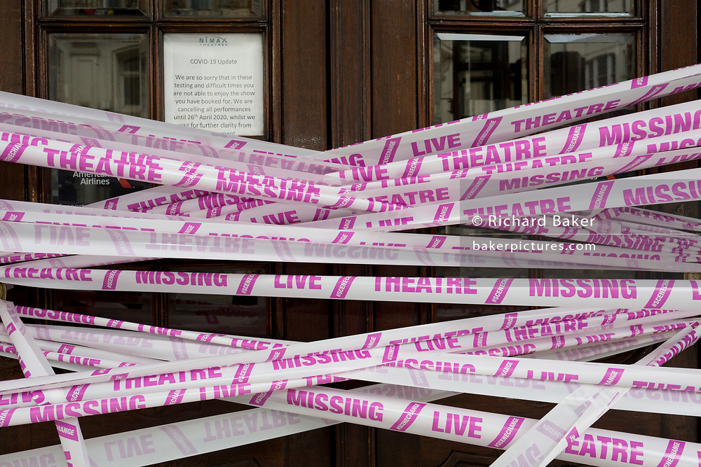 "The UK government has announced a Coronavirus pandemic financial rescue package for the Arts industry, a £1.15bn support for cultural organisations in England which is made up of £880m in grants and £270m of repayable loans. But venues such as The Apollo Theatre on Shaftesbury Avenue in London's West End Theatreland, where the musical Jamie was abandoned at the beginning of lockdown, will remain closed for the foreseeable future, on 6th July 2020, in London, England. Some theatres in London and others around the country have been wrapped in bright pink barrier tape, which reads ""Missing Live Theatre"" -  a protest project led by stage designers group Scene Change highlighting the closure of the arts and culture arts industry supports 137,250 jobs and is worth £21.2bn in direct turnover."