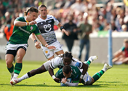 London Irish's Tom Parton (floor) is tackled by Sale Sharks' Marland Yarde during the Gallagher Premiership match at the Brentford Community Stadium, London. Picture date: Sunday September 26, 2021.
