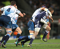 CAPE TOWN, SOUTH AFRICA - 11 JUNE 2011, Stormers wing Bryan Habana is tackled by Bulls captain Victor Matfield during the Super Rugby match between DHL Stormers and the Bulls held at DHL Newlands Stadium in Cape Town, South Africa..Photo by Shaun Roy / Sportzpics.net