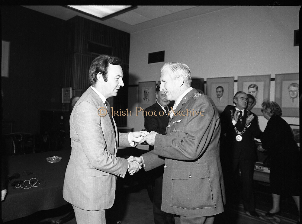People Of The Year Awards.    (N74).1981..05.05.1981..5th May 1981..Dr Michael Woods TD,Minister for Health & Social Welfare, today presented 73 People of The Year Lapel Emblems at an official ceremony in the New Ireland Assurance Co., Ltd, Dawson Street, Dublin. The lapel emblems were created as a result of recipients of the awards seeking to promote their work by identifying with the awards. It is intended that future recipients of The People Of The Year Awards silver medallions would also receive a lapel emblem...Image shows Michael Woods TD,Minister for Health and Social Welfare,presenting awards at the ceremony. Unfortunately we do not have a caption sheet. If you know the people involved why not let us know at irishphotoarchive@gmail.com