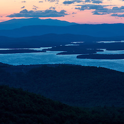 Lake Winnipesauke at sunset as seen from the summit of Mount Major in Gilford, New Hampshire.