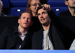 England Cricketers Eoin Morgan (left) and Steven Finn in the crowd during day six of the NITTO ATP World Tour Finals at the O2 Arena, London.