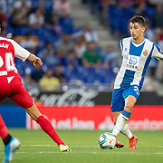 BARCELONA, SPAIN - August 18:  Marc Roca #21 of Espanyol passes the ball while defended by Joan Jordan #24 of Sevilla during the Espanyol V  Sevilla FC, La Liga regular season match at RCDE Stadium on August 18th 2019 in Barcelona, Spain. (Photo by Tim Clayton/Corbis via Getty Images)