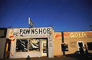 Pawnshop called The Happy Hocker in Palmdale, Mojave Desert, California, USA.