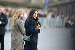 Meghan Markle smiles at wellwishers while on a walkabout on the esplanade at Edinburgh Castle, as she and Prince Harry visited Scotland.