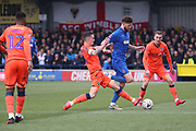 Millwall midfielder Shaun Williams (6) tackling AFC Wimbledon midfielder Anthony Wordsworth (40) during the The FA Cup 5th round match between AFC Wimbledon and Millwall at the Cherry Red Records Stadium, Kingston, England on 16 February 2019.