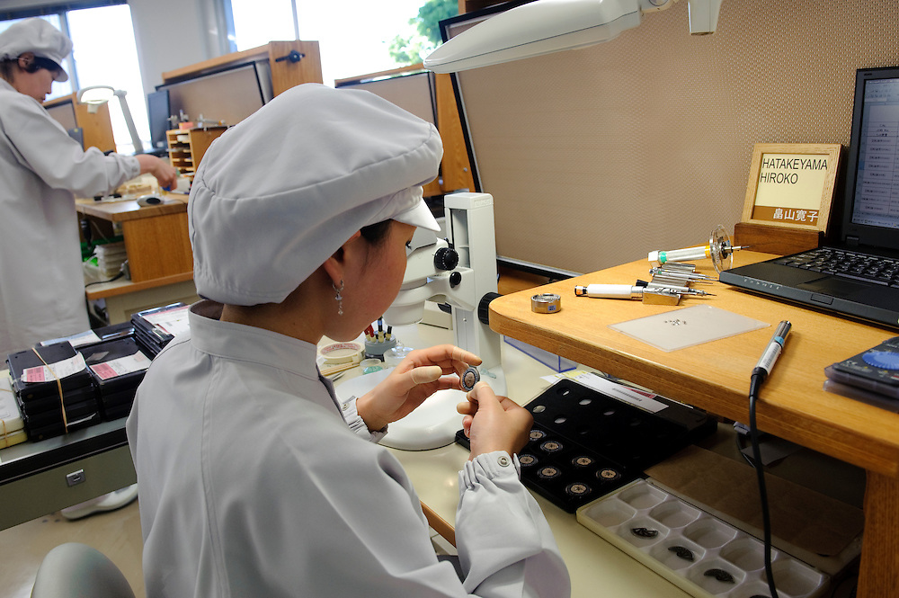 An engineer works on a watch in the Micro Artist Studio, Seiko Epson, Shiojiri, Japan, May 18, 2009. In the workshop Seiko-Epson make a range of luxury watches, including the Sonnerie.