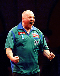England's Andy Hamilton celebrates beating Vincent van der Voort of the Netherland's, right, 4-3 to move to the next round in the Darts World Championships at Alexandra Palace, London, Tuesday, Dec.. 27, 2011. photo by morn/I-Images
