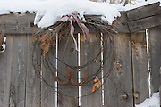 Horseshoe and barbed wire wreath with snow