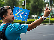 16 AUGUST 2015 - BANGKOK, THAILAND:  A man takes a selfie with his iPhone at the start of the Ride for Mom in Bangkok. More than 100,000 people across Thailand participated in the Bike For Mom event in honor of Queen Sirikit, who celebrated her 83rd birthday August 12. In Bangkok, the ride was led by His Royal Highness Crown Prince Maha Vajiralongkorn, the Crown Prince of Thailand and Sirikit's only son. Queen Sirikit, who is in poor health and living in a hospital, was unable to attend the bike ride.    PHOTO BY JACK KURTZ